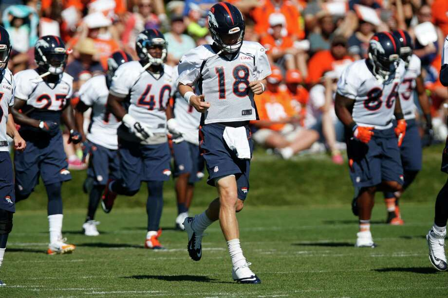 Denver Broncos quarterback Peyton Manning (18) during the morning session at the team's NFL training camp Wednesday, Aug. 12, 2015, in Englewood, Colo. (AP Photo/David Zalubowski) Photo: David Zalubowski, Stf / AP