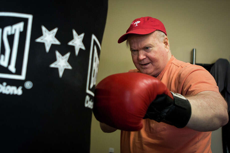 Pat Conroy works out at the fitness studio he opened as part of his makeover. In three years, he has lost 25 pounds, quit drinking, brought his blood pressure down and improved his diet. Illustrates HEALTH-CONROY (category l), by Nora Krug, (c) 2015, The Washington Post. Moved Tuesday, August 18, 2015. (MUST CREDIT: Photo by Alex Holt for The Washington Post.) Photo: HOLT, STR / Washington Post / THE WASHINGTON POST