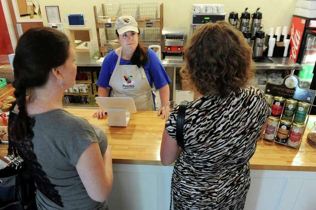 Owner Sara Mae Hickey, center, takes a lunch order on Tuesday, June 16, 2015, at Puzzles Bakery and Cafe in Schenectady, N.Y. (Cindy Schultz / Times Union) Photo: Cindy Schultz / 00032293A