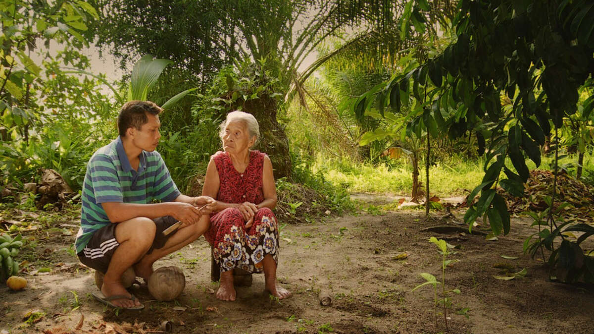 """Adi Rukun and his mother, Rohani, in """"The Look of Silence."""" The film focuses on the survivors of anti-Communist massacres of 1965 and 1966 in Indonesia. Illustrates INDONESIA-FILM (category i), by Adam Taylor (c) 2015, The Washington Post. Moved Monday, July 20, 2015. (MUST CREDIT: Courtesy of Drafthouse Films and Participant Media.)"""