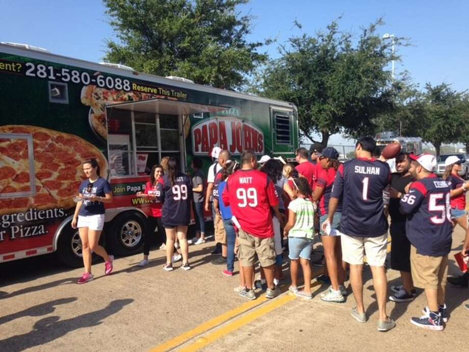 Papa John's mobile kitchen was at the Houston Texans practice this week to celebrate its relationship with new national spokesperson J.J. Watt. Photo: Courtesy Photo, Pappa John's