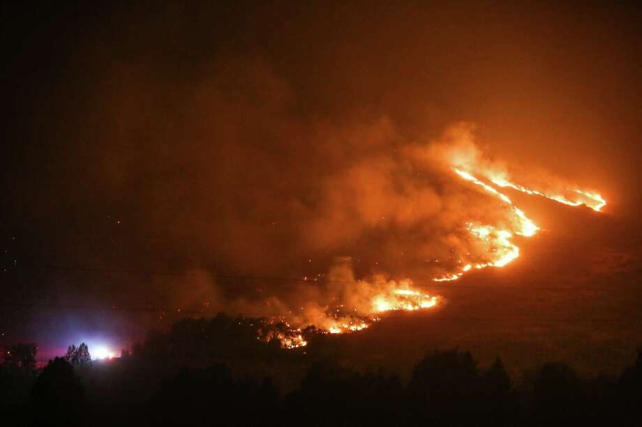 A fire burns in the hills around Twisp, Wash. Three firefighters were killed in the inferno. Photographed on Thursday, August 20, 2015. Photo: JOSHUA TRUJILLO, SEATTLEPI.COM / SEATTLEPI.COM