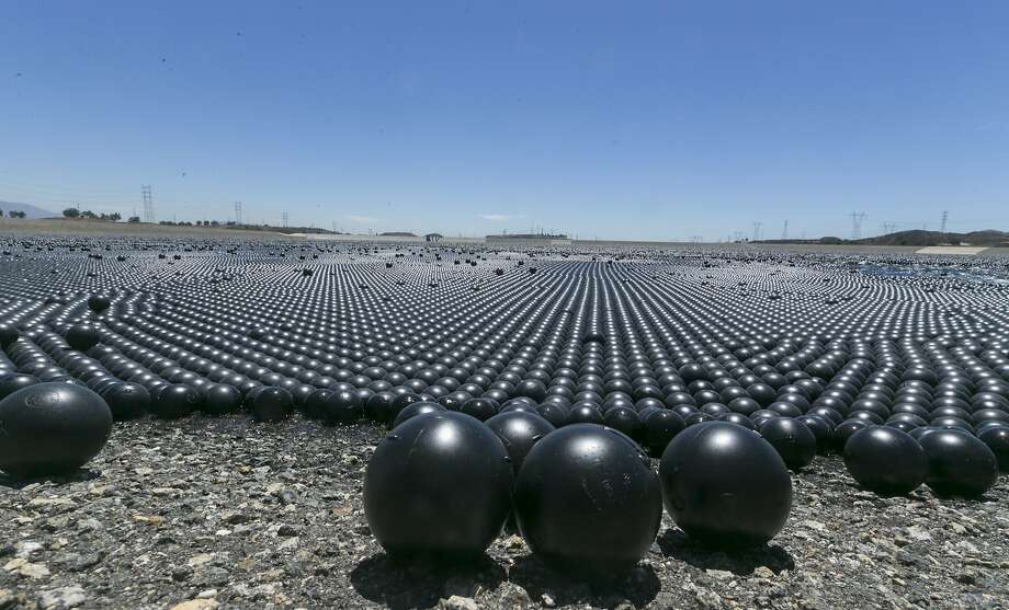 "Los Angeles covered a reservoir with ""shade balls"" to prevent algae blooms. Photo: Damian Dovarganes, Associated Press"