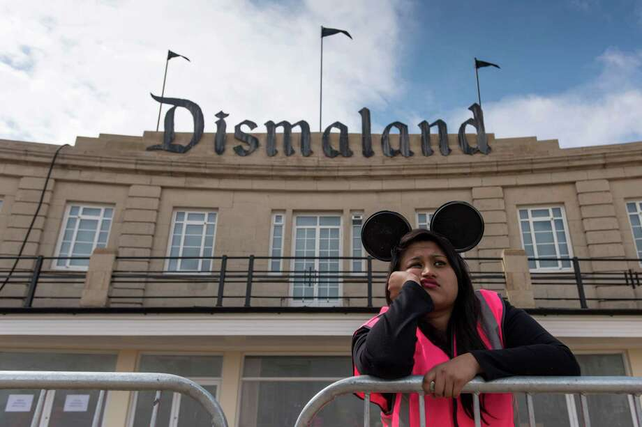 A steward is seen outside Bansky's 'Dismaland' exhibition, which opens tomorrow, at a derelict seafront lido on August 20, 2015 in Weston-Super-Mare, England. The show is Banskys first in the UK since the Banksy v Bristol Museum show in 2009 and will be open for 6 weeks at the Tropicana site. Photo: Matthew Horwood, Getty Images / 2015 Getty Images