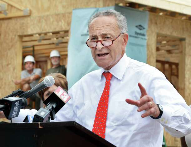 Sen. Charles Schumer launches his push to fight proposed steep funding cuts during a news conference in front of homes being rebuilt by Habitat for Humanity of Schenectady County, using HOME Program funding on Carrie St. Thursday August 20, 2015 in Schenectady, NY.  (John Carl D'Annibale / Times Union)(John Carl D'Annibale / Times Union) Photo: John Carl D'Annibale