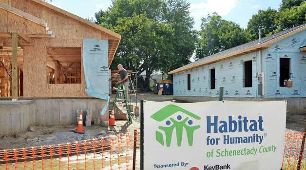 Homes being rebuilt by Habitat for Humanity of Schenectady County, using HOME Program funding on Carrie St. Thursday August 20, 2015 in Schenectady, NY.  (John Carl D'Annibale / Times Union)(John Carl D'Annibale / Times Union) Photo: John Carl D'Annibale