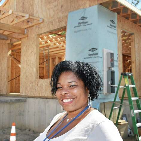 Home owner Karena Blackmon in front of her house being rebuilt by Habitat for Humanity of Schenectady County, using HOME Program funding on Carrie St. Thursday August 20, 2015 in Schenectady, NY.  (John Carl D'Annibale / Times Union)(John Carl D'Annibale / Times Union) Photo: John Carl D'Annibale