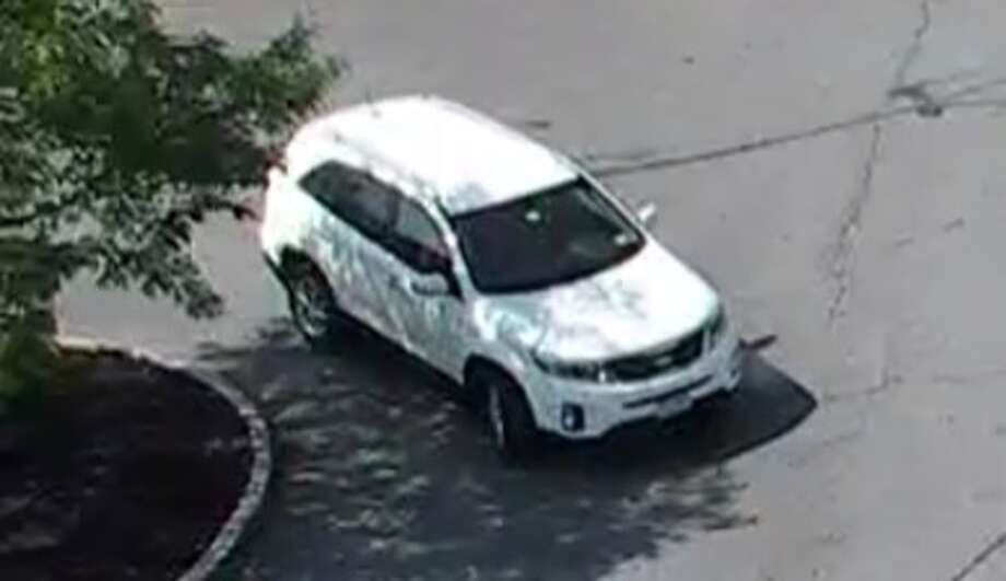 Colonie police are looking for the driver of this white Kia Sorento, who allegedly threw a teenager girl into a car and cracked the rear windshield. (Colonie police photo)