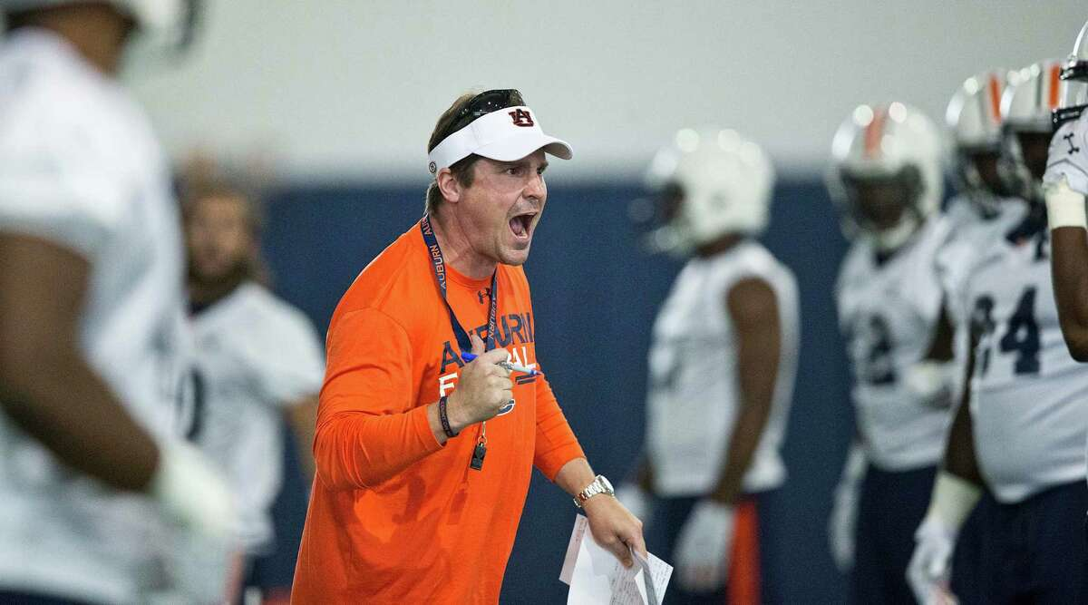 Auburn's defensive coordinator Will Muschamp screams at a player during an NCAA college football practice in Auburn, Ala., on Aug. 4, 2015. There are 14 new coordinators around the league, including Muschamp at Auburn.