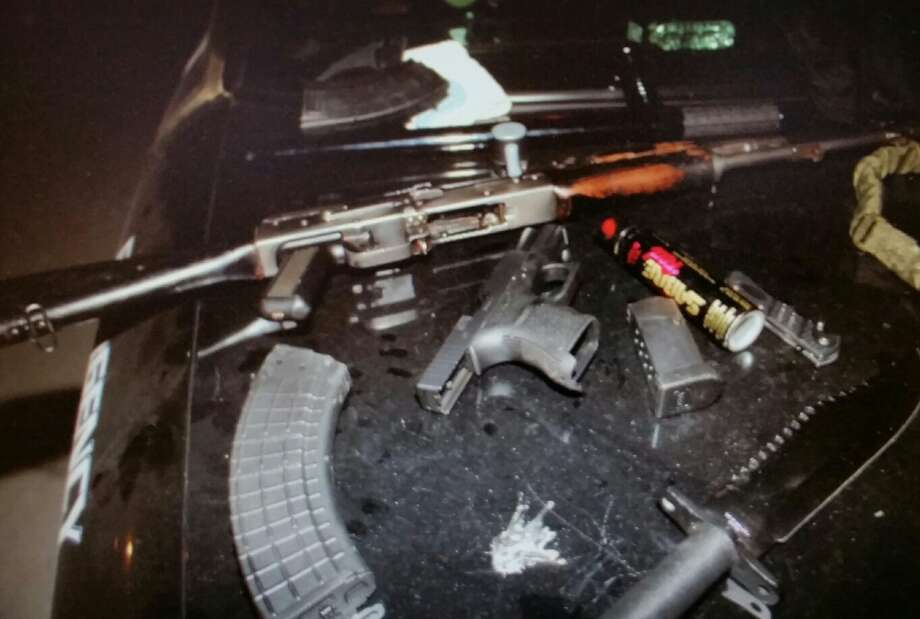 Border Patrol arrested a heavily-armed man who called himself a member of a Texas militia. He carried a pistol, an automatic long rifle, two large knives, a can of mace, a baton and tactical military garb. Photo: Laredo Police Department