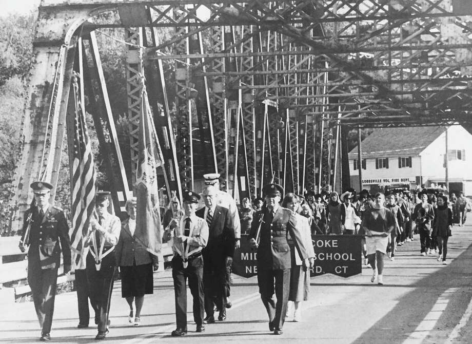 This image captures the final Memorial Day parade to cross the old Gaylordsville bridge before it was demolished in 1990 to make way for the current span across the Housatonic River. Among those marching are flagbearers Freddie O'Connor, whio has since died, and Herb Furhman, carrying the United States and Connecticut flags, respectively. Behind Furhman is Mayor Stuart Halpine, the first New Milford chief executive to bear that title. Those who would like to loan or contribute a photo from any of the Greater New Milford-area towns should bring it to the Greater New Milford Spectrum office at 45B Main St. or email ncummings@newstimes.com. If the photo is to be returned, please leave a phone number. Photo: Courtesy Of Herb Furhman / The News-Times Contributed