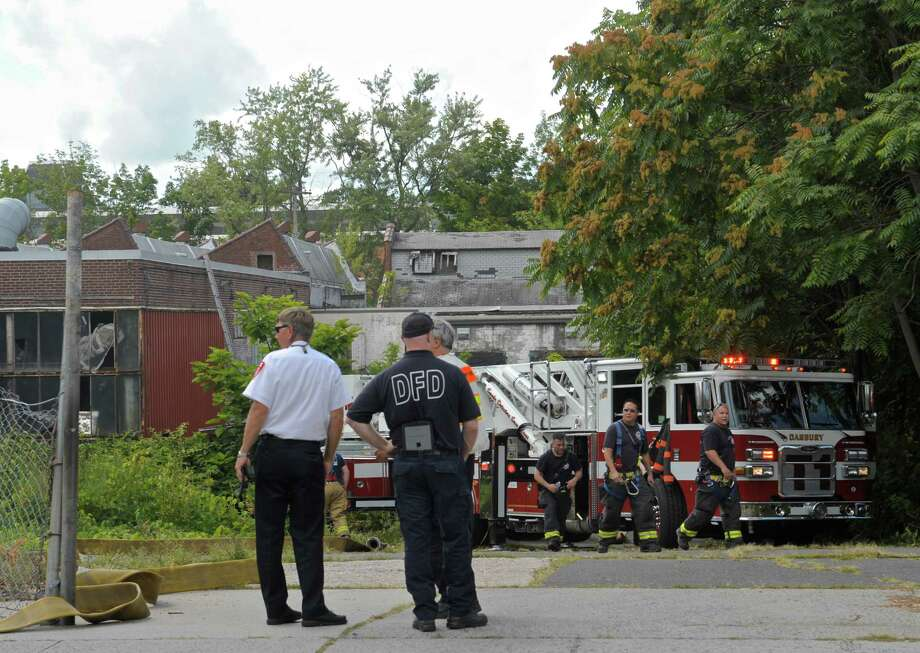 A mattress caught fire inside an old factory on Maple Avenue, near the corner of Garamella Boulevard, early Thursday afternoon causing heavy smoke inside the building. The fire was minor but it was difficult to put out because of the heavy smoke and hot weather. Thursday, August 20, 2015, in Danbury, Conn. Photo: H John Voorhees III / Hearst Connecticut Media / The News-Times