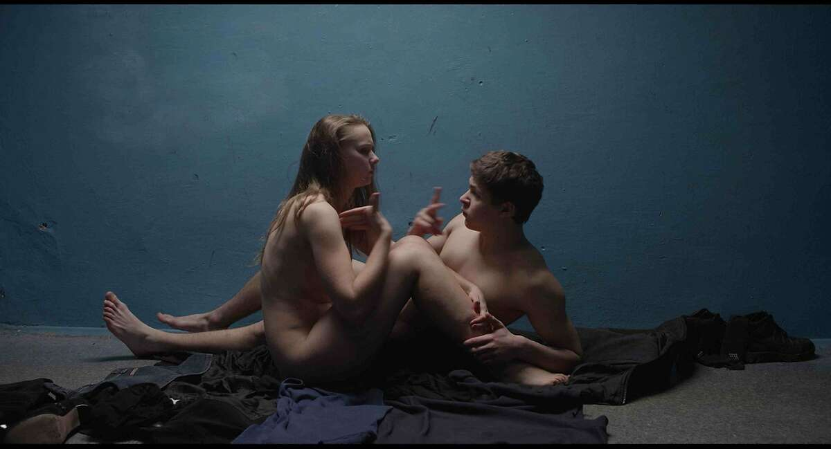 """Anya (Yana Novikova) and Sergey (Grigoriy Fesenko) sign during an intimate embrace in Drafthouse Films' """"The Tribe,"""" opening in Bay Area theaters, Friday, Sept. 4. Courtesy of Drafthouse Films."""