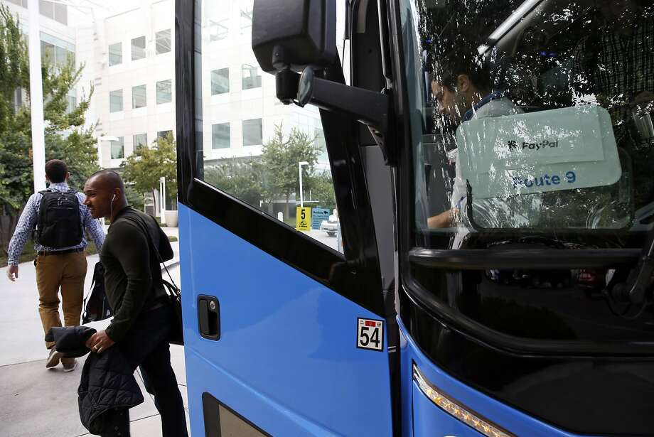 PayPal employees are dropped off at the company's corporate headquarters by a Compass Transportation bus driver in San Jose, Calif., on Wednesday, Aug. 19, 2015. Photo: Scott Strazzante, The Chronicle