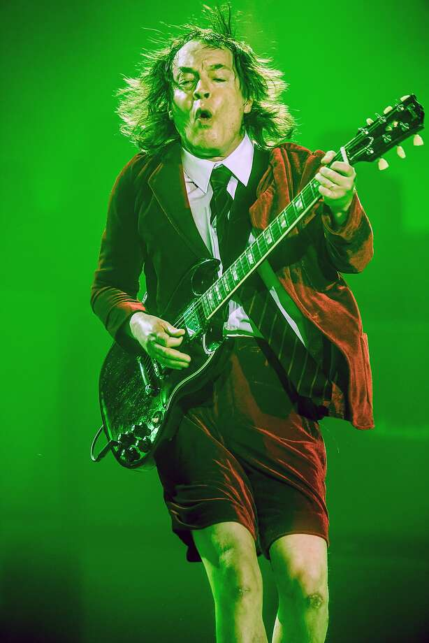 """Lead guitarist Angus Young in an earlier show on AC/DC's """"Rock or Bust"""" tour. Photo: Ralph Larmann, Associated Press"""