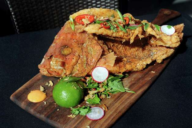 Special Crispy-fried Snapper with fresh herb salad on Thursday, Aug. 13, 2015, at The Patio at 15 Church in Saratoga Springs, N.Y. (Cindy Schultz / Times Union) Photo: Cindy Schultz / 00032979A