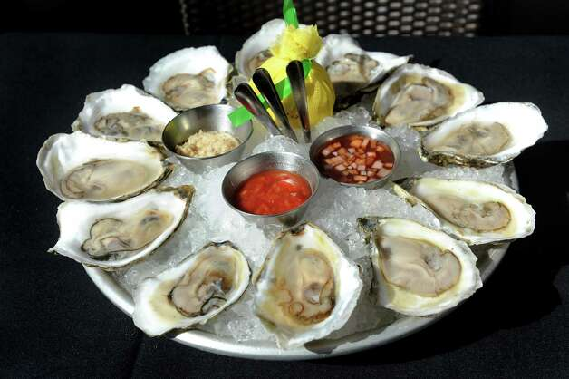 Katama Oysters from Martha's Vineyard with classic accutrements on Thursday, Aug. 13, 2015, at The Patio at 15 Church in Saratoga Springs, N.Y. (Cindy Schultz / Times Union) Photo: Cindy Schultz / 00032979A