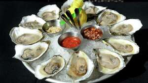 Katama Oysters from Martha's Vineyard with classic accutrements on Thursday, Aug. 13, 2015, at The Patio at 15 Church in Saratoga Springs, N.Y. (Cindy Schultz / Times Union)