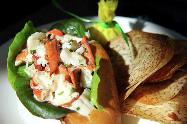 Classic Maine Lobster Roll served warm on a butter-toasted brioche bun and tara root chips on Thursday, Aug. 13, 2015, at The Patio at 15 Church in Saratoga Springs, N.Y. (Cindy Schultz / Times Union) Photo: Cindy Schultz / 00032979A