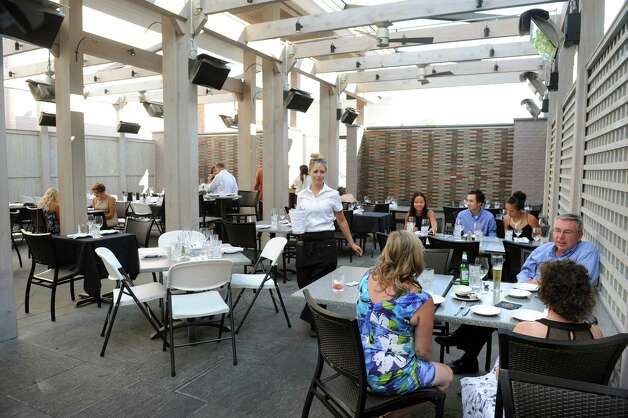 The dining room with a retractable roof on Thursday, Aug. 13, 2015, at The Patio at 15 Church in Saratoga Springs, N.Y. (Cindy Schultz / Times Union) Photo: Cindy Schultz / 00032979A