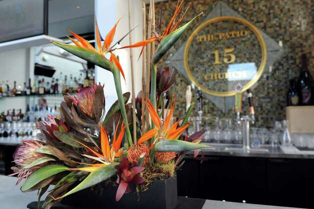 Bird of Paradise adorns the bar on Thursday, Aug. 13, 2015, at The Patio at 15 Church in Saratoga Springs, N.Y. (Cindy Schultz / Times Union) Photo: Cindy Schultz / 00032979A