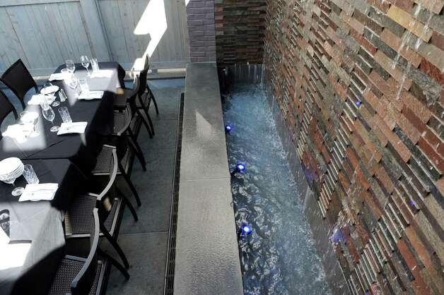 The waterfalls along the wall in the dining room on Thursday, Aug. 13, 2015, at The Patio at 15 Church in Saratoga Springs, N.Y. (Cindy Schultz / Times Union) Photo: Cindy Schultz / 00032979A