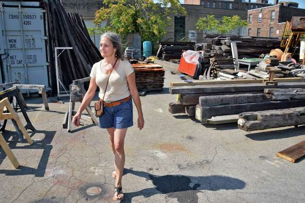 Camille Gibeau walks through a yard full of reclaimed materials at Silver Fox Salvage Friday August 14, 2015 in Albany, NY.  (John Carl D'Annibale / Times Union) Photo: John Carl D'Annibale / 00033008A