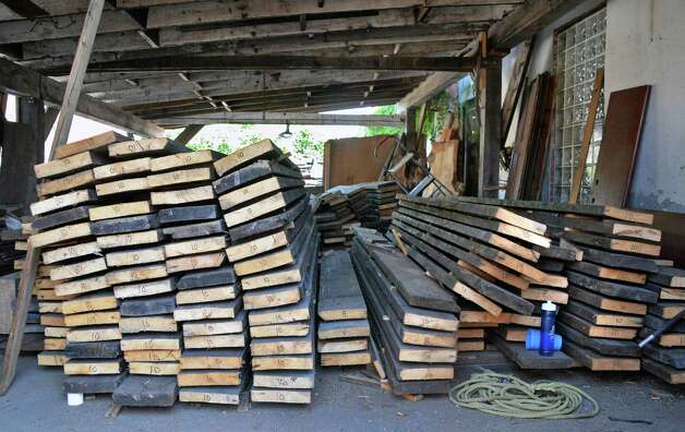 Reclaimed wooden beams stacked on sticks so they can air dry at Silver Fox Salvage Friday August 14, 2015 in Albany, NY.  (John Carl D'Annibale / Times Union) Silver Fox Salvage Friday August 14, 2015 in Albany, NY.  (John Carl D'Annibale / Times Union) Photo: John Carl D'Annibale / 00033008A