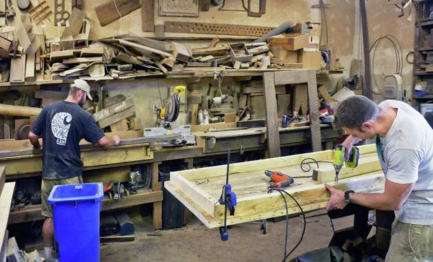 Woodworkers John Prian, left, and Matt Farr in the workshop at Silver Fox Salvage Friday August 14, 2015 in Albany, NY.  (John Carl D'Annibale / Times Union) Photo: John Carl D'Annibale / 00033008A