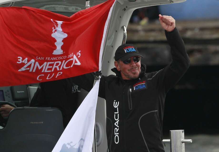 Oracle CEO Larry Ellison celebrates after Oracle Team USA won the second running of Race 13 of the America's Cup Finals on Friday, September 20, 2013 in San Francisco, Calif. The first running of Race 13 was abandoned due to exceeding time restrictions. Photo: Beck Diefenbach, Special To The Chronicle