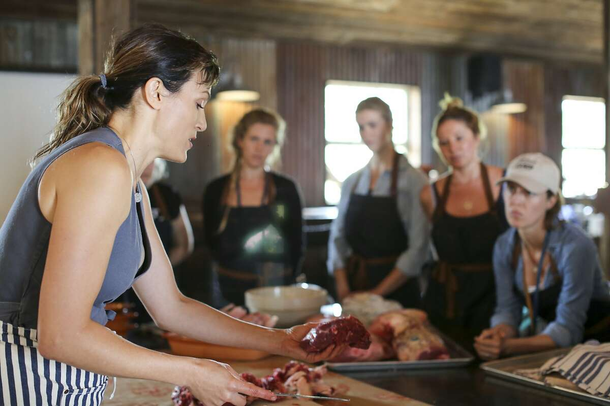 Rebecca Sullivan, Lindsey Ott, Analise Roland and Michelle Gaines watch as Belcampo CEO and co-founder, Anya Fernald, teaches a morning workshop at Belcampo?•s Meat Camp.
