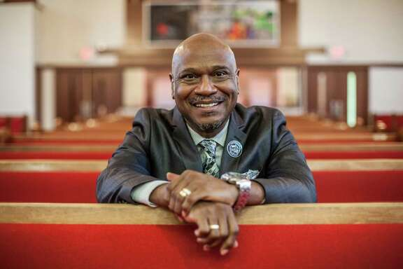 Dr. Shannon Lachlin Verrett, the pastor at Houston's Franklin Avenue Baptist Church, poses for a portrait inside the church Sunday August 16, 2015. Pastor Verrett came to Houston from New Orleans after Hurrican Katrina. (Michael Starghill, Jr.)