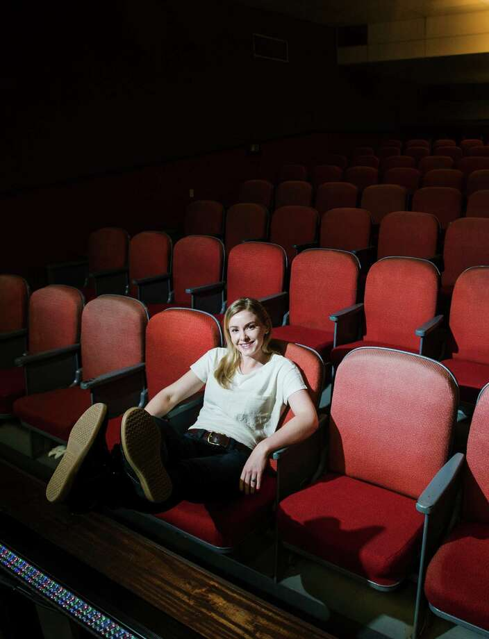 "Kate Robards poses for a photo at the Orange Community Players theater Wednesday afternoon. Robards, a West Orange-Stark graduate, is bringing her play, ""Mandarin Orange,"" to the stage of the Orange Community Players this weekend. The performance tells the story of her transition from small-town living in Orange to life as an expatriate in Shanghai, China. Robards is currently an MFA candidate at the California College of the Arts. Photo taken Wednesday 1/7/15 Jake Daniels/The Enterprise Photo: Jake Daniels / ©2014 The Beaumont Enterprise/Jake Daniels"