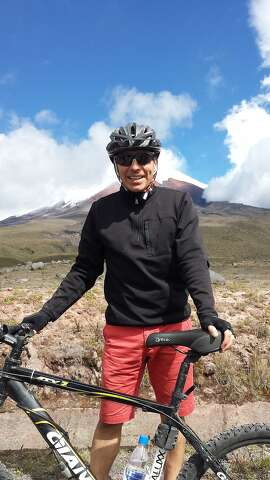 Paul Ybarbo, of San Francisco, at the base of Cotopaxi Volcano in the background.
