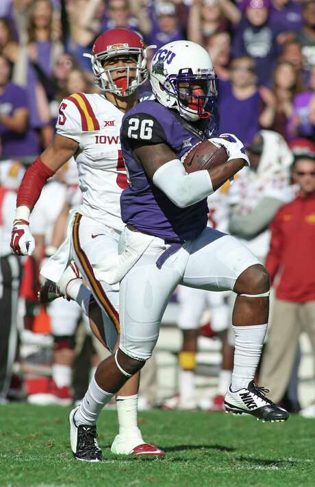 TCU safety Derrick Kindred (26) returns an interception for a touchdown during the third quarter of an NCAA college football game against Iowa State at Amon G. Carter Stadium, Saturday, Dec. 6, 2014, in Fort Worth. Photo: Paul Moseley /Fort Worth Star-Telegram / The Fort Worth Star-Telegram