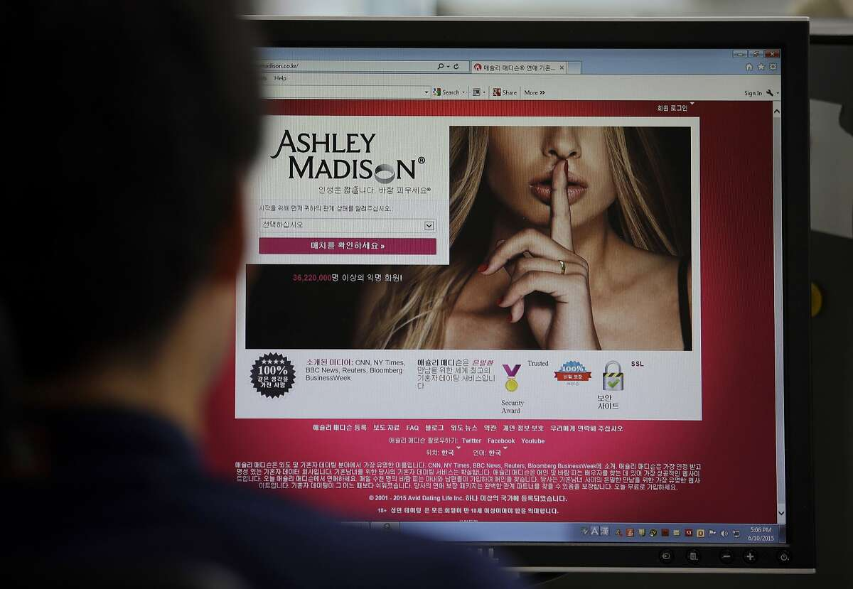 """A June 10, 2015 photo from files showing Ashley Madison's Korean web site on a computer screen in Seoul, South Korea. Hackers claim to have leaked a massive database of users from Ashley Madison, a matchmaking website for cheating spouses. In a statement released Tuesday, Aug. 18, 2015, a group calling itself Impact Team said the site's owners had not bowed to their demands. """"Now everyone gets to see their data,"""" the statement said. (AP Photo/Lee Jin-man, File)"""