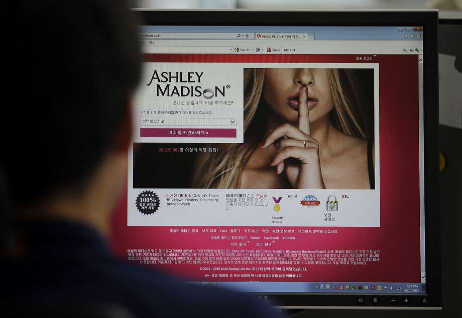 """A June 10, 2015 photo from files showing Ashley Madison's Korean web site on a computer screen in Seoul, South Korea. Hackers claim to have leaked a massive database of users from Ashley Madison, a matchmaking website for cheating spouses. In a statement released Tuesday, Aug. 18, 2015, a group calling itself Impact Team said the site's owners had not bowed to their demands. """"Now everyone gets to see their data,"""" the statement said. (AP Photo/Lee Jin-man, File) Photo: Lee Jin-man, Associated Press"""