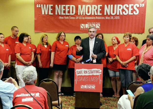 Schenectady Mayor Gary McCarthy, center, calls for continued talks with Ellis Medicine and members of the New York State Nurses Association to avoid a strike Thursday August 20, 2015 in Schenectady, NY.  (John Carl D'Annibale / Times Union) Photo: John Carl D'Annibale / 00033058A