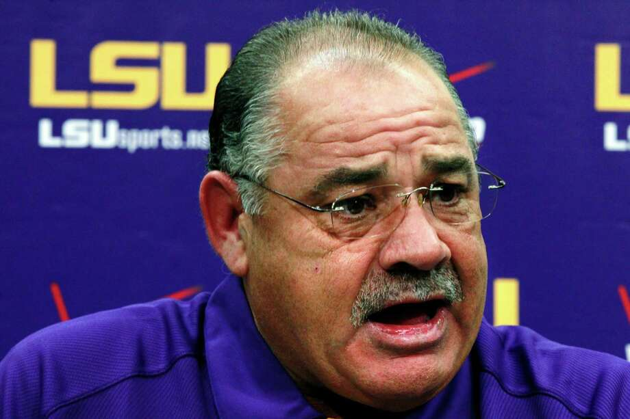 In this Aug. 7, 2012, file photo, then-LSU defensive coordinator John Chavis talks to reporters during their NCAA college football media day in Baton Rouge, La. The SEC will have 14 new coordinators this season. In typical SEC style, some have been spare-no-expense hires. Defensive coordinators Will Muschamp of Auburn and John Chavis of Texas A&M are each making at least $5 million over the next three years at their new jobs. Photo: Gerald Herbert /Associated Press / AP