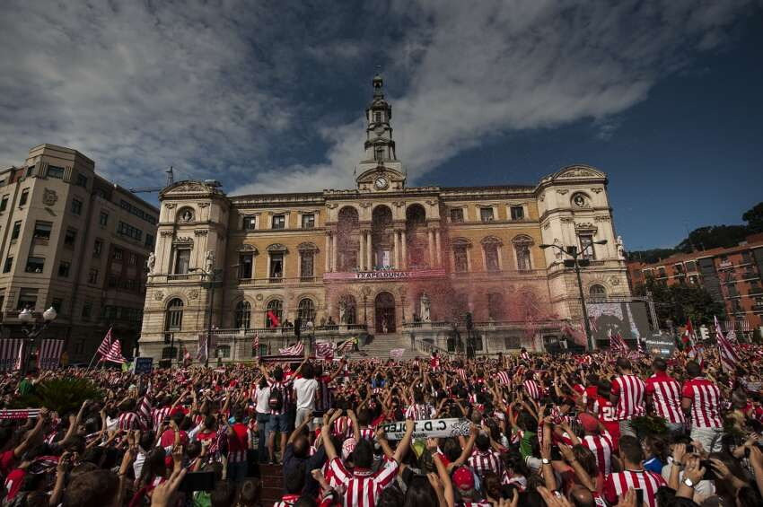 Bilbao, Spain Athletic Bilbao soccer team celebrate from the balcony of City Hall as fans look on after their team's victory of Spanish Super Cup against FC Barcelona, in Bilbao, northern Spain, Wednesday, Aug.18, 2015.