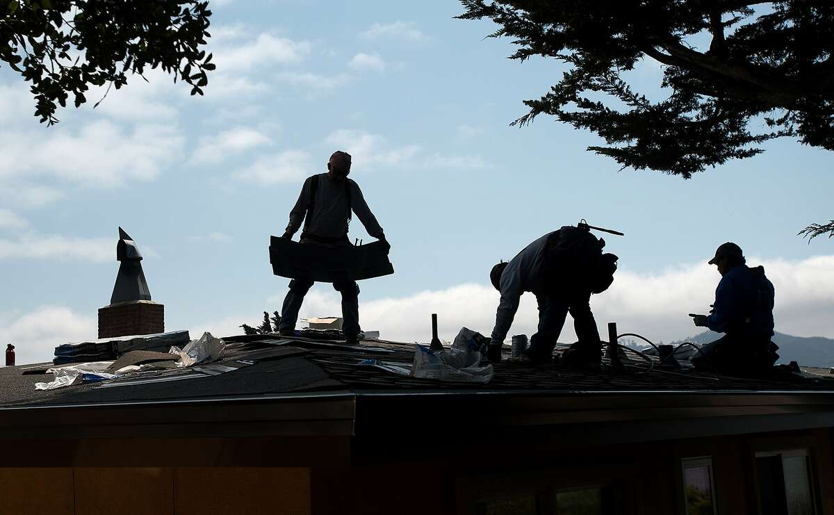 ARS Roofing employees work on a home in Tiburon, California on Thursday, August 20, 2015. The U.S. Climate Prediction Center has said they expect rain soon, sending homeowners scrambling to finish repairs ahead of the weather. (JOSH EDELSON / SPECIAL TO THE CHRONICLE)