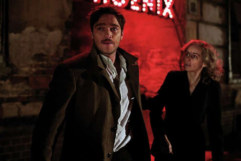 "In this image released by IFC Films, Ronald Zehrfeld, left, and Nina Hoss appear in a scene from ""Phoenix."" (Christian Schulz/IFC Films via AP) ORG XMIT: NYET408 Photo: Christian Schulz / IFC Films"
