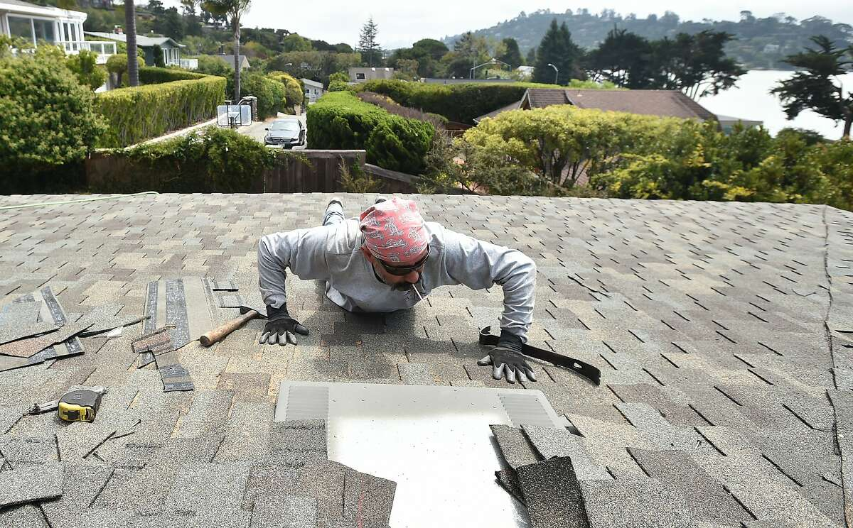 Pedro Carreno of ARS Roofing works on a home in Tiburon, California on Thursday, August 20, 2015. The U.S. Climate Prediction Center has said they expect rain soon, sending homeowners scrambling to finish repairs ahead of the weather. (JOSH EDELSON / SPECIAL TO THE CHRONICLE)