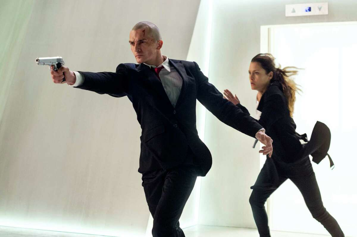 """In this image released by Twentieth Century Fox, Rupert Friend, left, and Hannah Ware appear in a scene from, ?""""Hitman: Agent 47."""" (Reiner Bajo/Twentieth Century Fox via AP) ORG XMIT: NYET714"""