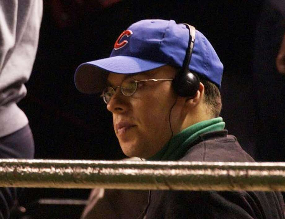 Chicago Cubs fan Steve Bartman sits in the stands at Wrigley Field in Chicago during the eighth inning of Game 6 of the NLCS  between the Chicago Cubs and the Florida Marlins Tuesday, Oct. 14, 2003. Earlier in the inning, Bartman tried to grab a foul ball, preventing Cubs outfielder Moises Alou from catching it. That helped the Florida Marlins rally for an 8-3 victory to tie the NL championship series. Bartman apologized Wednesday, Oct. 15, 2003, saying he was brokenhearted. Photo: Scott Strazzante, AP