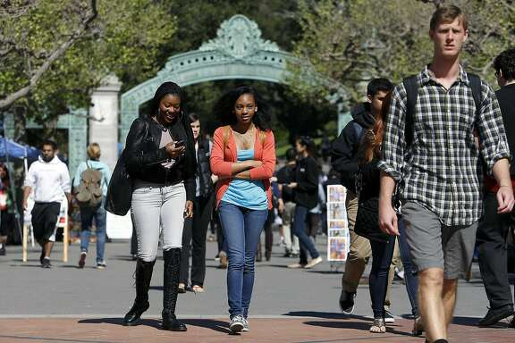 Freshman students Jillian Merriweather, left, and Cheyenne Williams walk through Sproul Plaza between classes at Cal in Berkeley, CA, Tuesday, March 11, 2014.   State legislature is considering restoring the ability of California universities to use race and ethnicity in admissions decisions.