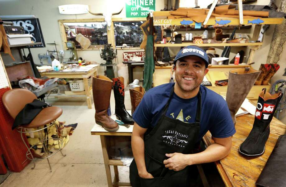 Jason Gawlik makes custom cowboy boots the old-fashioned way, even though he's a young guy. Gawlik posed for a portrait Tuesday, Aug. 18, 2015, in Houston.  Some of his equipment is more than 100 years old. He works in the back of Texas National Outfitters, 8933 Katy Freeway. ( Steve Gonzales / Houston Chronicle ) Photo: Steve Gonzales, Staff / © 2015 Houston Chronicle