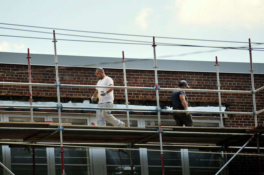 Construction work continues on the facade of Dolan Middle School. Photo: Jason Rearick / Hearst Connecticut Media / Stamford Advocate