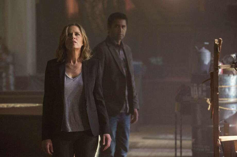 "This photo provided by AMC shows, Kim Dickens, left, as Madison and Cliff Curtis as Travis in a scene from ""Fear the Walking Dead,"" season 1. The series, a spinoff to AMC's ""The Walking Dead,"" debuts 9 p.m. EST Sunday, Aug. 23, 2015. (Frank Ockenfels 3/AMC via AP) Photo: Frank Ockenfels 3, HONS / Associated Press / AMC"