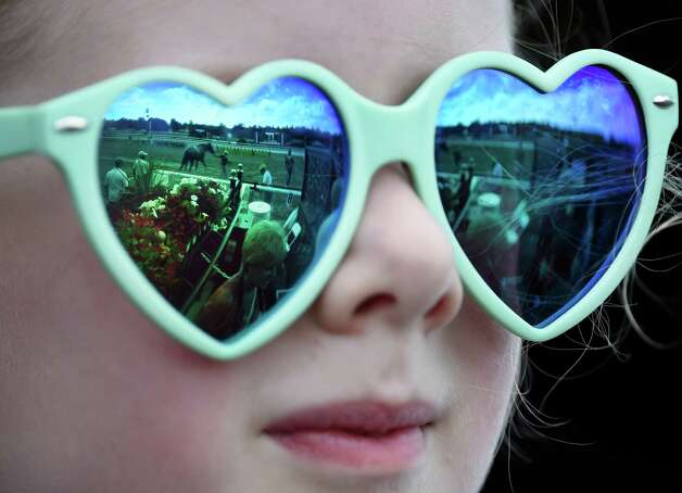 Teagan Harrelson, 6, of Seattle, Washington shows the love of horses in her sun glasses during racing on the main track at the Saratoga Race course Thursday afternoon Aug. 20, 2015 after morning exercise  in Saratoga Springs, N.Y.    (Skip Dickstein/Times Union) Photo: SKIP DICKSTEIN